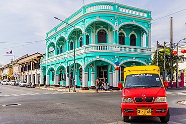 A local taxi tuk tuk and beautiful Sino-Portuguese architecture in Phuket old town, Phuket, Thailand, Southeast Asia, Asia
