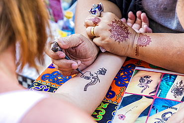 A henna tattoo being applied at the famous Walking Street night market in Phuket old Town, Phuket, Thailand, Southeast Asia, Asia