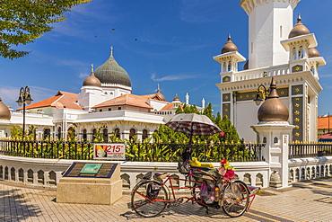 A local rickshaw (tuk tuk) outside Kapitan Keling Mosque, George Town, Penang Island, Malaysia, Southeast Asia, Asia