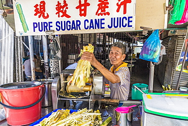 A pure sugar cane juice stall in George Town, Penang Island, Malaysia, Southeast Asia, Asia.