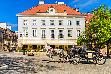 A horse drawn carriage in the New Town in Warsaw, Poland, Europe.