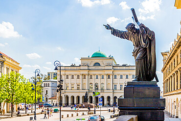 A statue and the Polish Academy of Sciences in the background in the Old Town, a UNESCO World site in Warsaw, Poland, Europe.