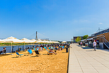 The beach and outdoor restaurants along the Vistulan Boulevards in Warsaw, Poland, Europe.