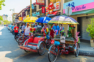 Tuk Tuks in George Town, a UNESCO World Heritage site, Penang Island, Malaysia, Southeast Asia, Asia.