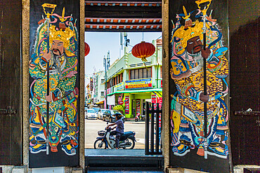 Ornate doors at Han Jiang Ancestral Temple in George Town, a UNESCO World site, Penang Island, Malaysia, Southeast Asia, Asia.