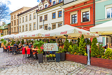 A cafe scene in Kazmierz, the historical former Jewish District in Krakow, Poland, Europe.