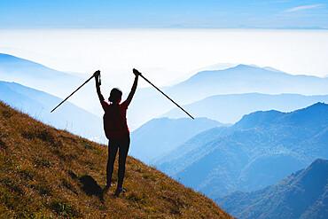 Mountain Trekker enjoy the freedom in Adamello park, Lombardy district, Brescia province, Italy.
