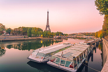 View of Eifel Tower on the Seine River early in the morning in Autumn
