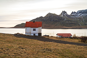 Traditional Icelandic house in Stodvarfjordur by the Fjords in East Iceland, Iceland, Polar Regions