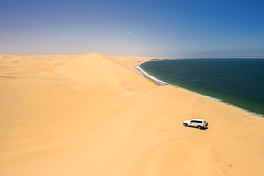 Drone shot of car in Sandwich Harbour, Namibia, Africa