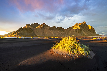 Dramatic light with view of the mountains of Vestrahorn from black volcanic sand beach at sunset, Stokksnes, South Iceland, Iceland, Polar Regions