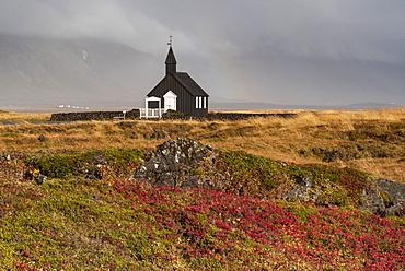 Budir Black church in autumn backed by the Snaefellsnes mountains, Budir, Snaefellsnes Peninsula, Iceland, Polar Regions