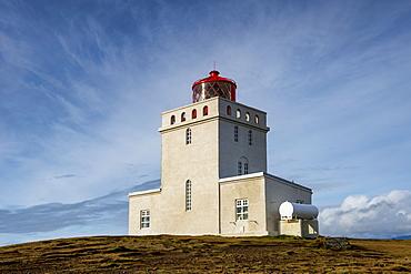 Kap Dyrholaey Lighthouse, to the east the Reynisdrangar, near Vik, South Coast, Iceland, Polar Regions