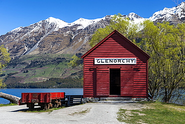 The red boat house in Glenorchy in spring, Queenstown Lakes district, Otago region, South Island, New Zealand, Pacific