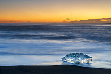Single Ice formation at sunrise on ice beach at Jokulsarlon, Iceland, Polar Regions