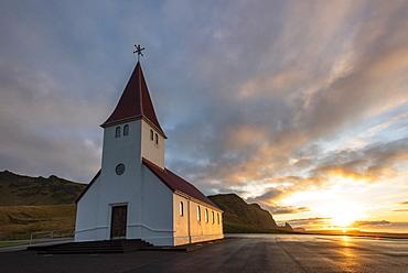 Vik church at sunrise, near Vik, South Iceland, Iceland, Polar Regions