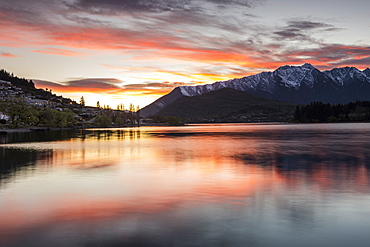 Queenstown and Bob's Peak with red sky at sunrise, Otago, South Island, New Zealand, Pacific