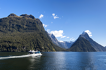 Sightseeing cruise ship at Milford Sound, Fiordland National Park, UNESCO World Heritage Site, South Island, New Zealand, Pacific