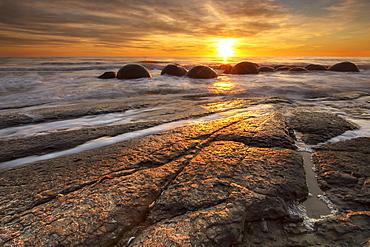 The Moeraki Boulders at sunrise, Moeraki Beach, Otago, South Island, New Zealand, Pacific