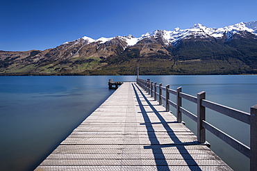 Wooden jetty leading into turquoise Lake Wakitipu, Queenstown, Otago, South Island, New Zealand, Pacific