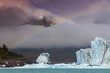 Rainbow and dramatic cloud over Perito Moreno Glacier in Los Glaciares National Park, UNESCO World Heritage Site, Patagonia, Argentina, South America