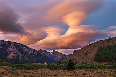 Lenticular clouds above The Chilean Saddle, Bariloche, Patagonia, Argentina, South America