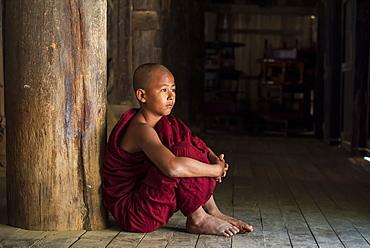 Young Buddhist monk at temple, Bagan (Pagan), Myanmar (Burma), Asia