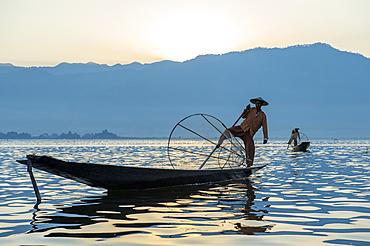Intha leg rowing fisherman fishing, Inle Lake., Shan State, Myanmar (Burma), Asia