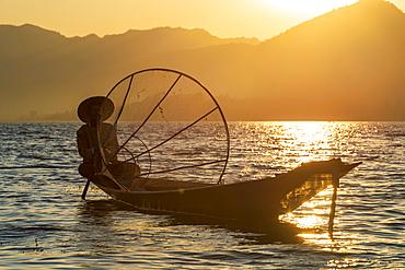 Intha leg rowing fisherman at sunset on Inle Lake, Shan State, Myanmar (Burma), Asia