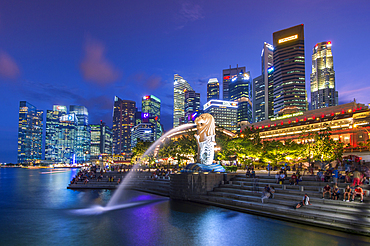 The Merlion at Marina Bay with The Fullerton Hotel set against The Financial District at night, Singapore, Southeast Asia, Asia