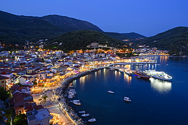 The elevated view of Parga town at night, Parga, Preveza, Greece, Europe