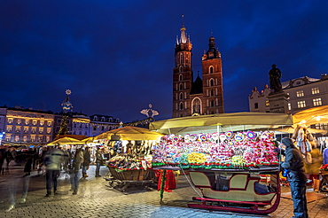 Christmas markets at night with Saint Mary's Basilica, Market Square, UNESCO World Heritage Site, Krakow, Poland, Europe