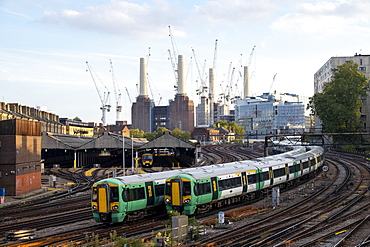 Passenger trains travelling towards London Victoria station with Battersea Power Station under construction, London, England, United Kingdom, Europe