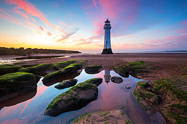 Perch Rock lighthouse with amazing sunset, New Brighton, Cheshire, England, United Kingdom, Europe