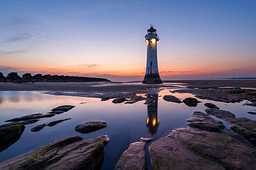 Perch Rock lighthouse with beautiful sunset, New Brighton, Cheshire, England, United Kingdom, Europe
