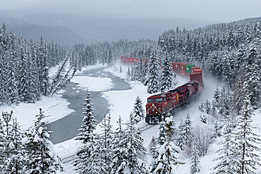Canadian Pacific train at Morant's Curve in winter along the Bow River, Banff National Park, UNESCO World Heritage Site, Alberta, Canada, North America
