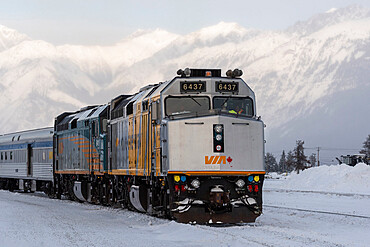 VIA Rail train with snow covered mountain backdrop, Jasper, Canadian Rocky Mountains, Alberta, Canada, North America
