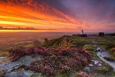 A dramatic sunrise at Cloudside with heather, Near Congleton, Cheshire, England, United Kingdom, Europe