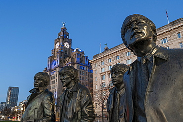The Beatles statue at night, Liverpool waterfront, Liverpool, Merseyside, England, United Kingdom, Europe