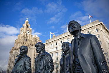 The bronze statue of the Beatles stands on Liverpool Waterfront, Liverpool, Merseyside, England, United Kingdom, Europe