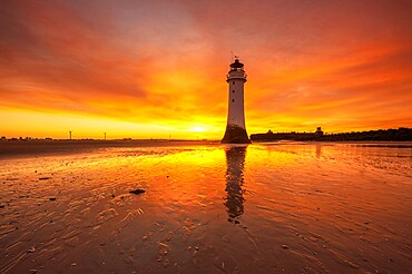 Perch Rock Lighthouse with dramatic sunrise, New Brighton, Cheshire, England, United Kingdom, Europe