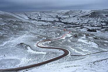 Car light trails on winding road in winter, Edale, Derbyshire, England, United Kingdom, Europe