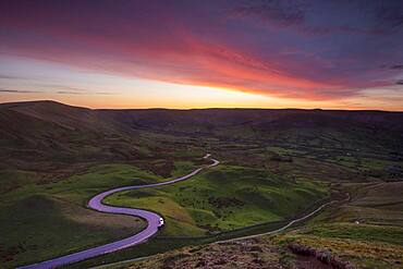 Spectacular sunset at Rushup Edge with winding road leading to Edale, Peak District, Derbyshire, England, United Kingdom, Europe