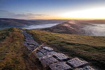 The path at Mam Tor leading to Losehill at sunrise, Peak District, Derbyshire, England, United Kingdom, Europe