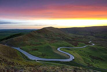 Sunset at Rushup Edge with winding road leading to Edale, Peak District, Derbyshire, England, United Kingdom, Europe