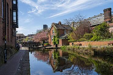 The Castlefield Canal with lock keeper house reflected in spring, Manchester, England, United Kingdom, Europe