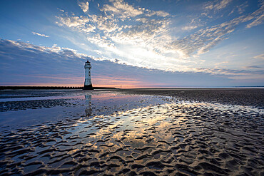 New Brighton Lighthouse reflected in sand at sunset, New Brighton, Cheshire