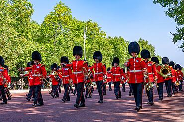 Guards Military Band marching towards Buckingham Palace on The Mall, London, England, United Kingdom, Europe