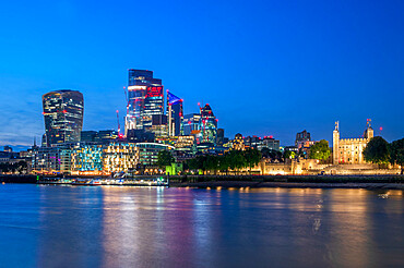 Evening view of The Tower of London and cityscape, London