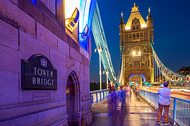 Evening view of Tower Bridge with light trails, London